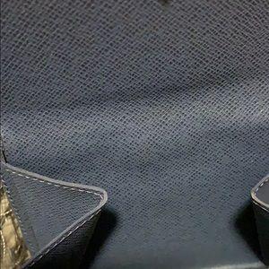 Louis Vuitton Bags - Louis Vuitton Blue Epi wallet w/pouch